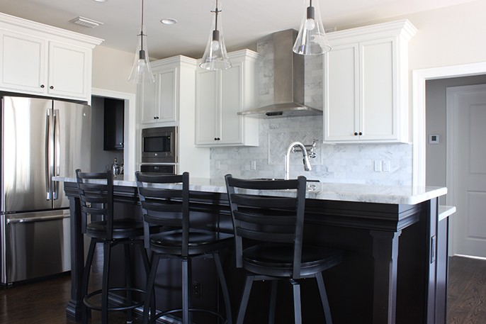 Mixed Metals Kitchen Chrome Bronze Pendants Black Barstools Black Island Hop Up Bar Super White Quartzite Black Leathered Granite
