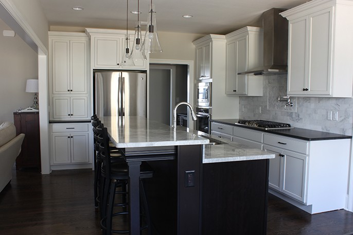 Mixed Metals Kitchen Chrome and Bronze Hardware Traditional Hop Up Island Black Cabinets Leathered Granite Super White Quartzite