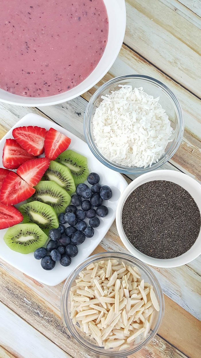 super yum, super charged, super food healthy smoothie bowl recipe with strawberry, blueberry, coconut, almond, spinach, kale, chia seeds